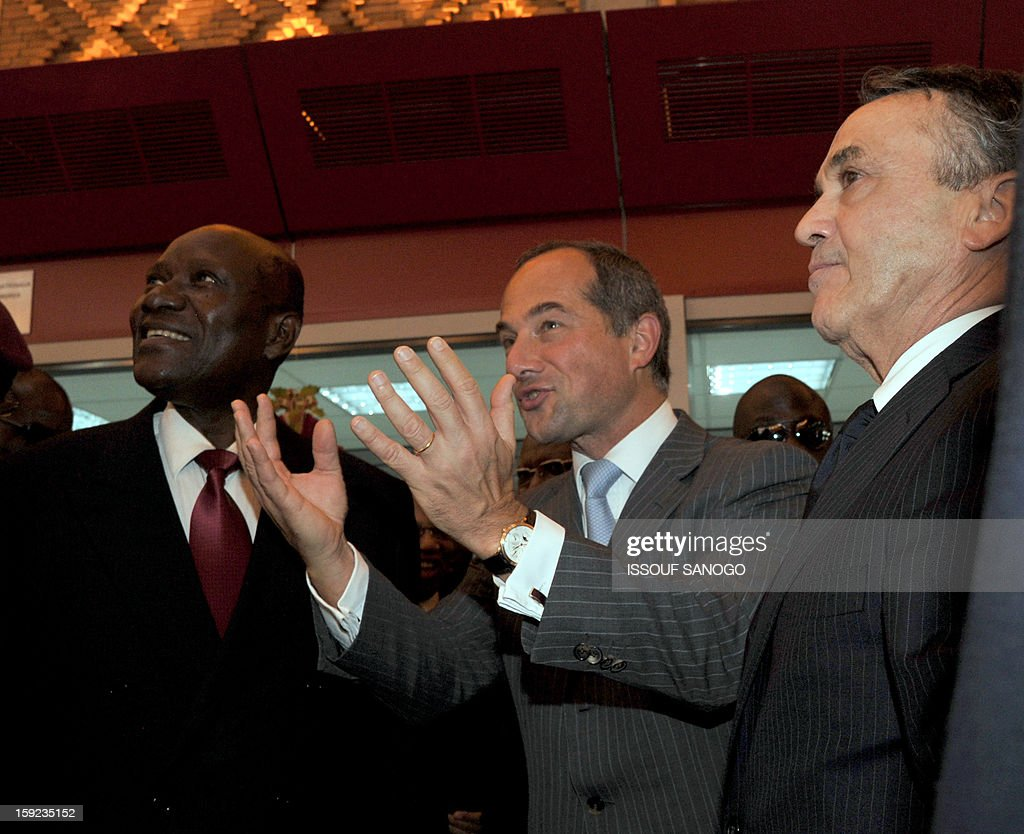 Ivorian Prime Minister Daniel Kablan Duncan, the chief executive officer of French bank Societe Generale, Frederic Oudea, and Societe Generale de Banque in Ivory Coast (SGBCI) national director Bernard Labadens inaugurate on January 10, 2013 the lobby of SGBCI headquarters in Abidjan during events marking the bank's 50th anniversary in Ivory Coast.