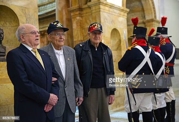 From left Iwo Jima survivors Larry Kirby Robert Johnson and Anthony Schiavi stand with some members of the US Marine Guard 1812 from the USS...