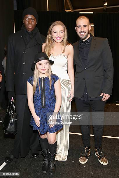 From left J Alexander actresses Maisy Stella and Lennon Stella and designer Idan Cohen pose backstage at the Idan Cohen fashion show during...