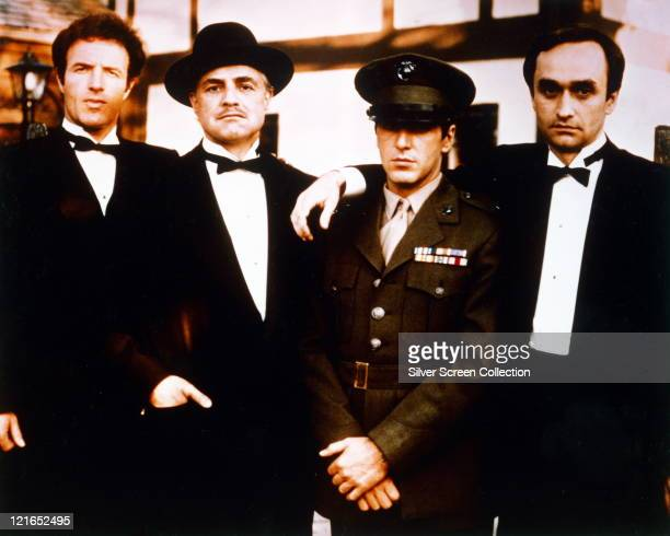 James Caan US actor Marlon Brando US actor Al Pacino US actor and John Cazale US actor all in black suits shite shirts and black bow ties except for...