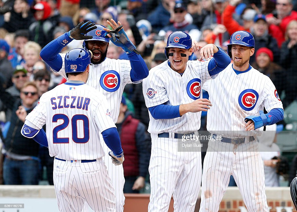 From left, <a gi-track='captionPersonalityLinkClicked' href=/galleries/search?phrase=Jason+Heyward&family=editorial&specificpeople=5043351 ng-click='$event.stopPropagation()'>Jason Heyward</a> #22, <a gi-track='captionPersonalityLinkClicked' href=/galleries/search?phrase=Anthony+Rizzo&family=editorial&specificpeople=7551494 ng-click='$event.stopPropagation()'>Anthony Rizzo</a> #44, and <a gi-track='captionPersonalityLinkClicked' href=/galleries/search?phrase=Ben+Zobrist&family=editorial&specificpeople=2120037 ng-click='$event.stopPropagation()'>Ben Zobrist</a> #18 congratulate Matt Szczur #20 of the Chicago Cubs after Szczur hit a grand slam in the eighth inning against the Atlanta Braves at Wrigley Field on April 29, 2016 in Chicago, Illinois.