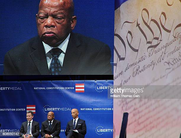 From left Jeffrey Rosen President and CEO of the National Constitution Center civil rights icon Rep John Lewis and host Byron Pitts wait to present...