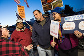 From left Jerry Kumar Glenn Anderson and Davene Kaplan protest Republican presidential candidate Sen Ted Cruz's public lands position outside of the...