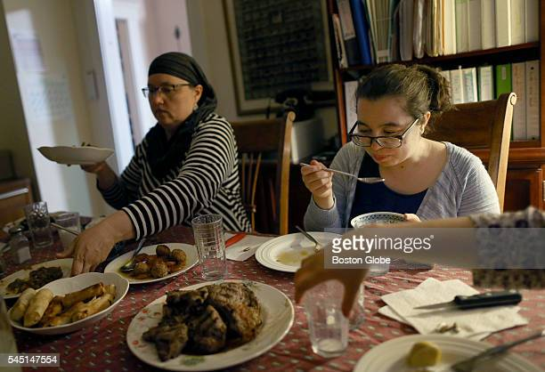 From left Jessica Allison and her daughters Aicha Belabbes and Emma Nour Belabbes have iftar the meal marking the end of a day's fast during Ramadan...