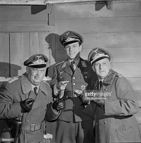 John Banner as Sgt Hans Georg Schultz Bob Crane as Col Robert E Hogan and Werner Klemperer as Col Wilhelm Klink in The Great Impersonation an episode...