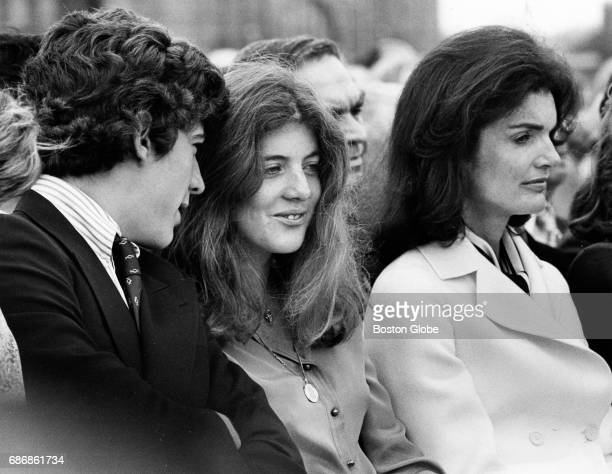 From left John F Kennedy Jr Caroline Kennedy and Jacqueline Kennedy Onassis sit at the groundbreaking for the John F Kennedy Presidential Library and...