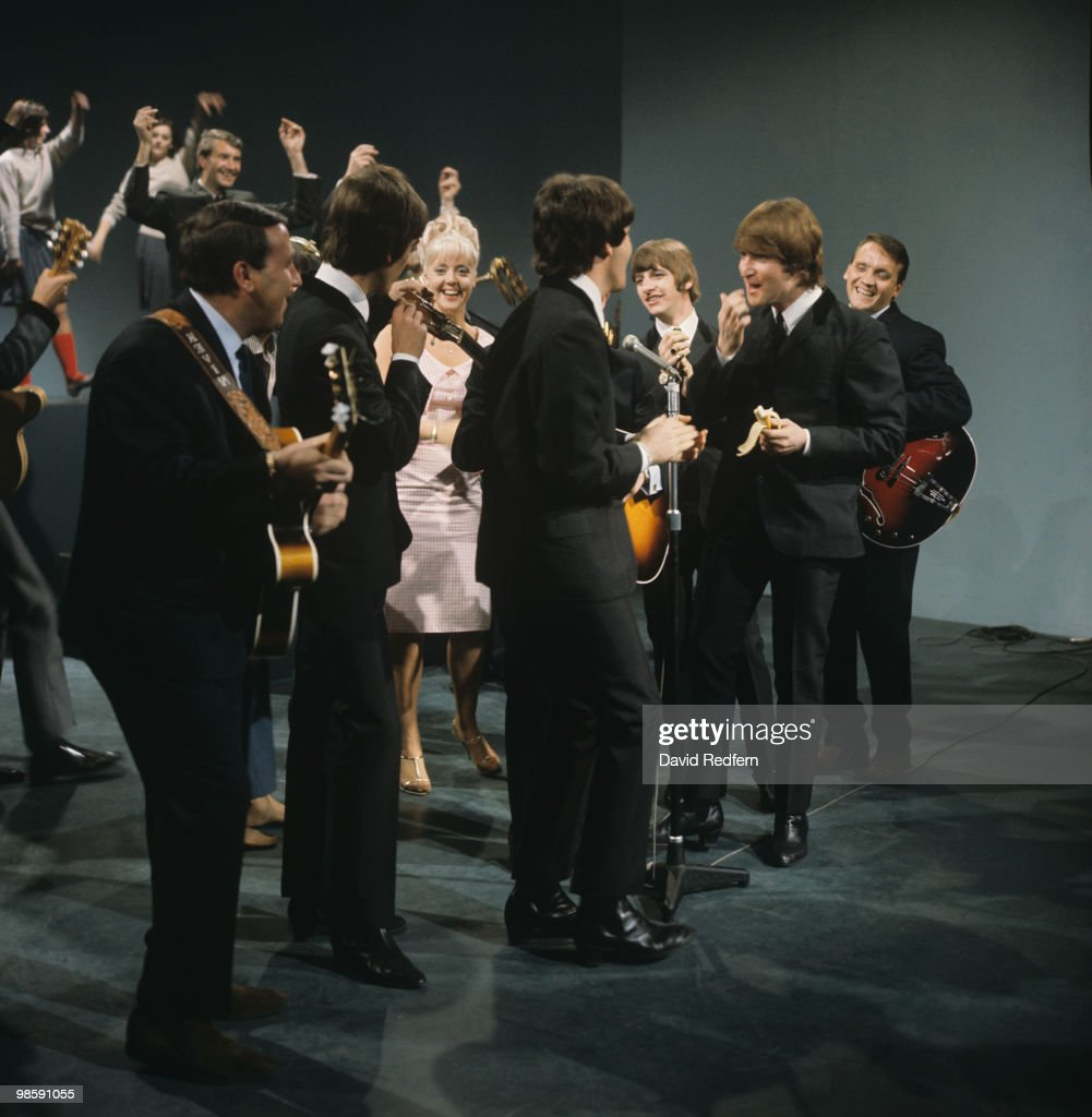 George Harrison, Paul McCartney, Ringo Starr and John Lennon of The Beatles perform on 'Shindig!' television show filmed at the Granville Studios in London, England on October 03, 1964.