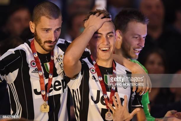 Juventus' defender from Italy Leonardo Bonucci Juventus' forward from Argentina Paulo Dybala and Juventus' goalkeeper from Brazil Neto celebrate...