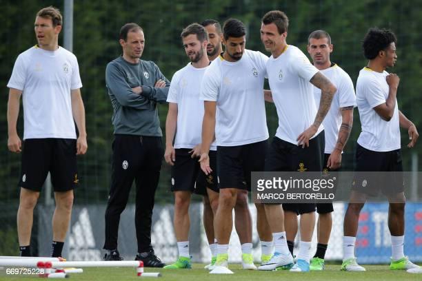 Juventus' defender from Switzerland Stephan Lichtsteiner Juventus' coach from Italy Massimiliano Allegri Juventus midfielder Miralem Pjanic Juventus'...