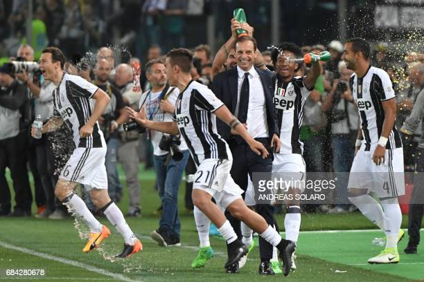 Juventus' defender from Switzerland Stephan Lichtsteiner Juventus' forward from Argentina Paulo Dybala Juventus' forward from Colombia Juan Cuadrado...