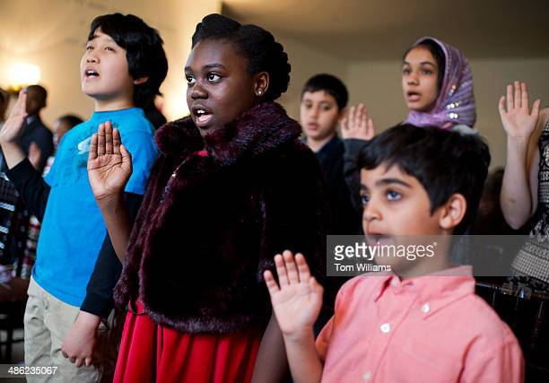 From left Kari Naga originally from Japan Gloria Gao of Sudan and Ahmed Soheim of Egypt participate in a citizenship ceremony at President Lincolns...
