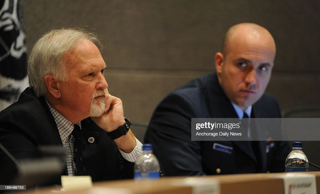 From left, Keith Fawcett, of the U.S. Coast Guard, and Coast Guard Lt. Dan Peters listen as Sean Churchfield, Shell Operation Manager for Alaska, answers questions during a Coast Guard hearing on Saturday, May 25, 2013, in Anchorage, Alaska. The hearing focused on the grounding of the Shell Oil Company drill ship Kulluk in December 2012.