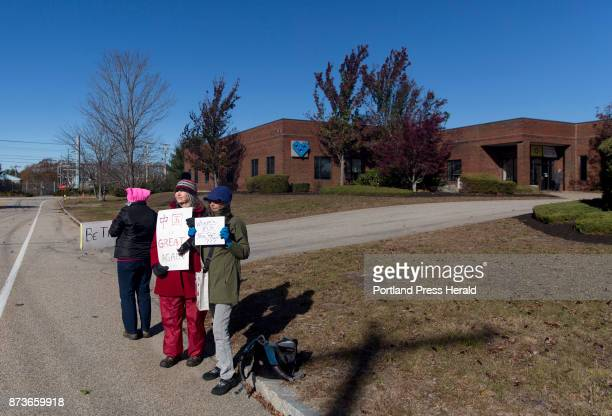 From left Laura Labbe of Brunswick Suzanne Sayer of Kittery and Susie Crimmins of Portland protest on the street outside of Volk Packaging...