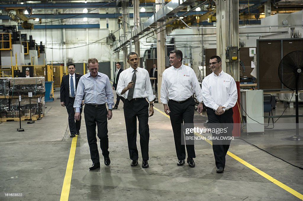 From left Linamar Group Vice President Phil McCulloch, US President Barack Obama, Linamar General Manager Mark Treffinger and Linamar Operations Manager Thomas Grein tour the Linamar factory February 13, 2013 in Arden, North Carolina. Obama toured the factory prior to speaking about his economic growth plan which he proposed about in last night's State of the Union. AFP PHOTO/Brendan SMIALOWSKI