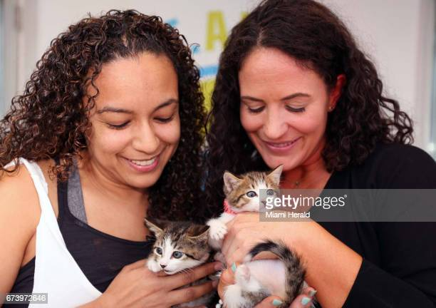 From left Lorna Mejia chief of shelter services for Miami Dade Animal Services and Tara Smith the yoga instructor during the first yoga with cats...