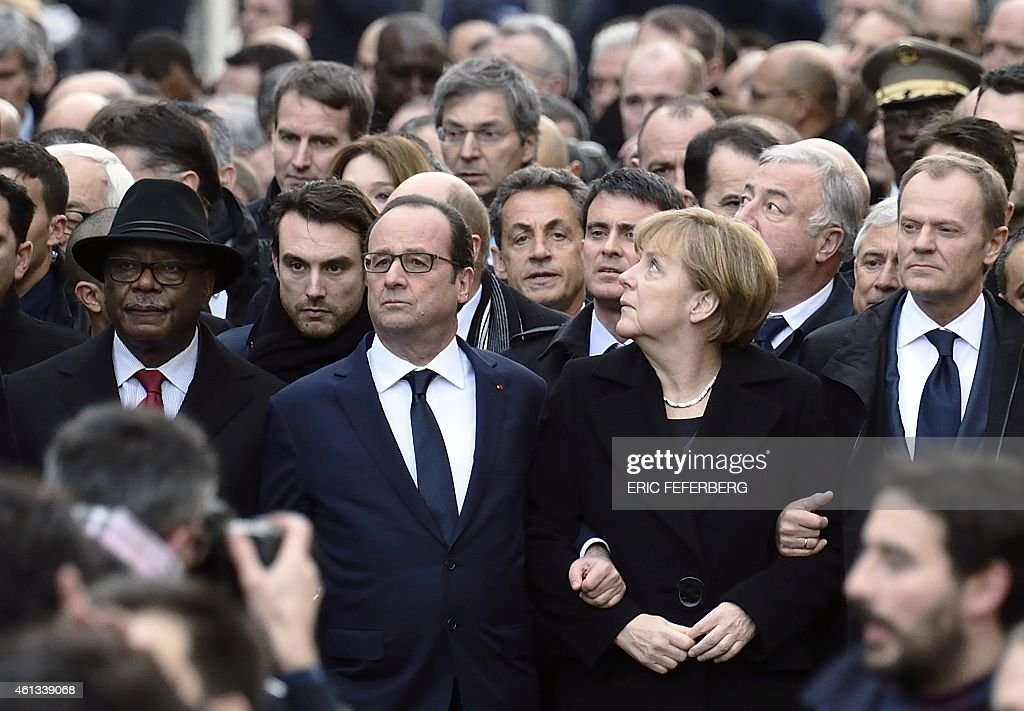 Malian President Ibrahim Boubacar Keita, French President Francois Hollande, France's former President and leader of the right-wing UMP party <a gi-track='captionPersonalityLinkClicked' href=/galleries/search?phrase=Nicolas+Sarkozy&family=editorial&specificpeople=211375 ng-click='$event.stopPropagation()'>Nicolas Sarkozy</a> (center back), France's Prime Minister <a gi-track='captionPersonalityLinkClicked' href=/galleries/search?phrase=Manuel+Valls&family=editorial&specificpeople=2178864 ng-click='$event.stopPropagation()'>Manuel Valls</a>, German Chancellor <a gi-track='captionPersonalityLinkClicked' href=/galleries/search?phrase=Angela+Merkel&family=editorial&specificpeople=202161 ng-click='$event.stopPropagation()'>Angela Merkel</a>, and European Union President <a gi-track='captionPersonalityLinkClicked' href=/galleries/search?phrase=Donald+Tusk&family=editorial&specificpeople=870281 ng-click='$event.stopPropagation()'>Donald Tusk</a>, along with other officials and heads of states take part in a Unity rally 'Marche Republicaine' on January 11, 2015 in Paris in tribute to the 17 victims of the three-day killing spree. The killings began on January 7 with an assault on the Charlie Hebdo satirical magazine in Paris that saw two brothers massacre 12 people including some of the country's best-known cartoonists and the storming of a Kosher supermarket on the eastern fringes of the capital which killed 4 local residents.