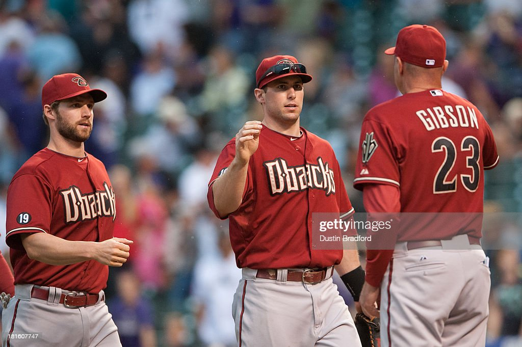 From left, <a gi-track='captionPersonalityLinkClicked' href=/galleries/search?phrase=Matt+Davidson+-+Baseball+Player&family=editorial&specificpeople=15052724 ng-click='$event.stopPropagation()'>Matt Davidson</a> #24 and <a gi-track='captionPersonalityLinkClicked' href=/galleries/search?phrase=Paul+Goldschmidt&family=editorial&specificpeople=7511120 ng-click='$event.stopPropagation()'>Paul Goldschmidt</a> #44 of the Arizona Diamondbacks celebrate the win with manager <a gi-track='captionPersonalityLinkClicked' href=/galleries/search?phrase=Kirk+Gibson&family=editorial&specificpeople=207042 ng-click='$event.stopPropagation()'>Kirk Gibson</a> #23 against the Colorado Rockies at Coors Field on September 22, 2013 in Denver, Colorado.