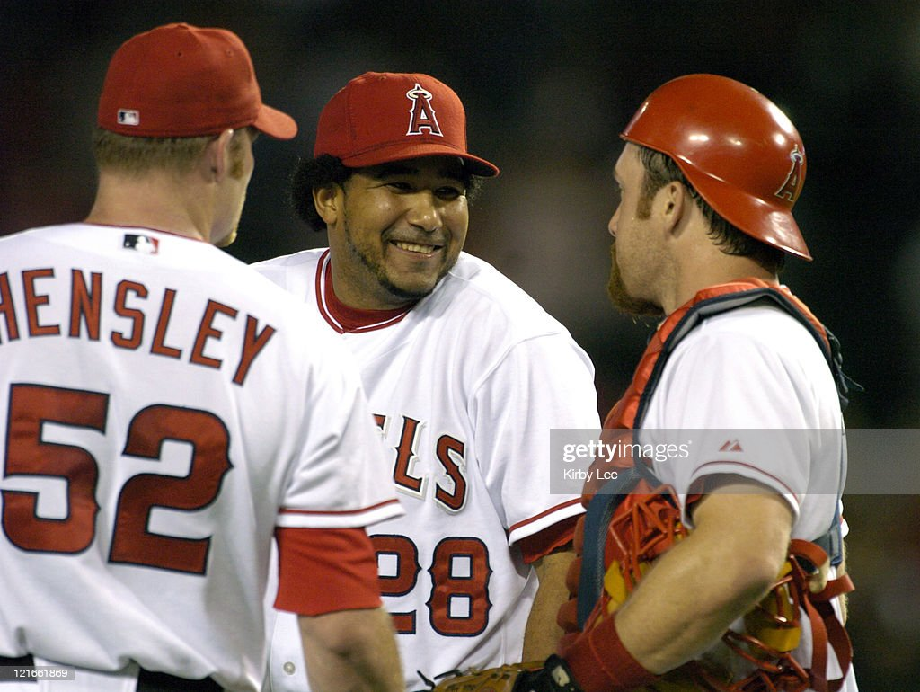 Matt Hensley, Jose Molina and Josh Paul celebrate after the final out of the Anaheim Angels' 21-6 victory over the Kansas City Royals at Angel Stadium in Anaheim, Calif. on Wednesday, August 25, 2004.