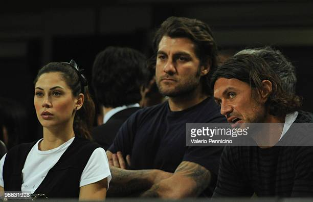 From left Melissa Satta Christian Vieri and Paolo Maldini sit in the stands during the Serie A match between AC Milan and ACF Fiorentina at Stadio...