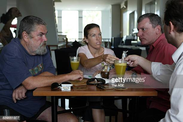 From left Michael Corby and his daughter Mercedes Corby meet with Australian QC Mark Trowell and his associate Phillip Laskaris partly obscured in a...