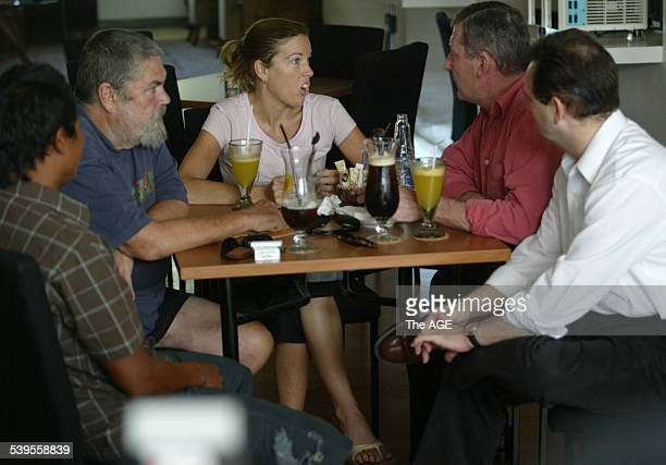 From left Michael Corby and his daughter Mercedes Corby meet with Australian QC Mark Trowell and his associate Phillip Laskaris in a cafe in Bali to...