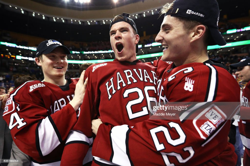 From left, Michael Floodstrand #44 of the Harvard Crimson, Jacob Olson #26 and Devin Tringale #22 celebrate after defeating Boston University Terriers 6-3 in the 2017 Beanpot Tournament Championship at TD Garden on February 13, 2017 in Boston, Massachusetts.