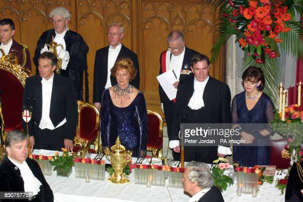 From left middle Prime Minister Tony Blair the Lady Mayoress Lord Ervine and Cherie Blair attend the Lord Mayor's Banquet at London's Guild Hall