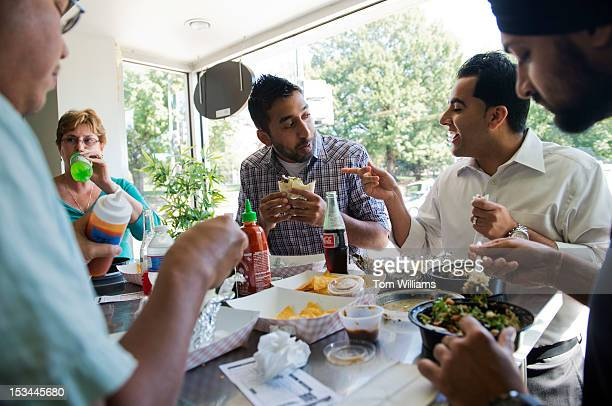 From left Mike Favila Janet Thornhill Sundeep Singh Ritul Walia and Pradip Singh have lunch at Chinito's Burritos on Florida Avenue NE