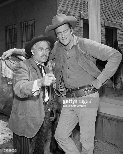 GUNSMOKE From left Milburn Stone as Dr Galen 'Doc' Adams and James Arness as Marshal Matt Dillon Image dated May 7 1958