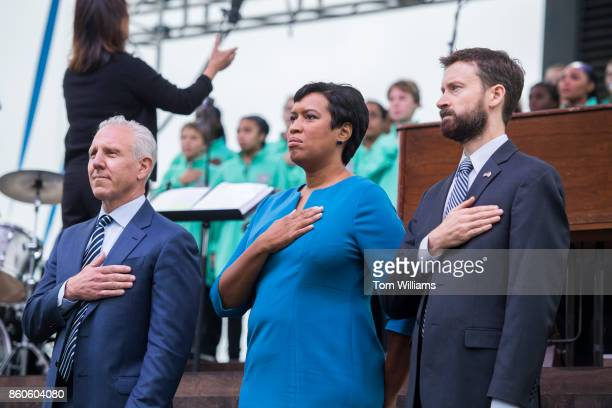 From left Monty Hoffman DC Mayor Muriel Bowser and District Ward 6 Council member Charles Allen appear during the opening ceremony of the Wharf...