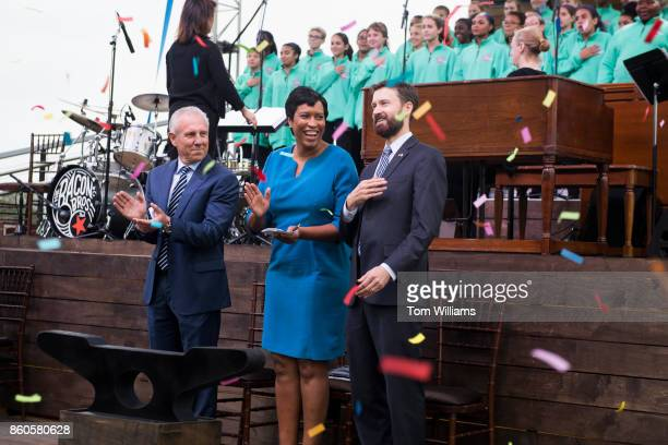 From left Monty Hoffman DC Mayor Muriel Bowser and Ward 6 Councilmember Charles Allen appear during the opening ceremony of the Wharf complex along...