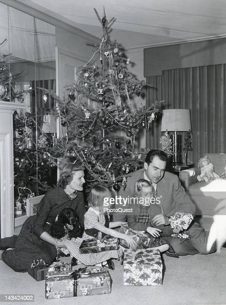 From left Mrs Richard Nixon holding cocker spaniel Checkers daughters Julie and Patricia and VicePresident Richard M Nixon as the family prepares for...