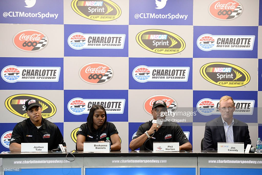 From left, NASCAR Drive for Diversity Pit Crew National Combine participants Joshua Tate and Brehanna Daniels, Rev Racing Director of Athletic Performance Phil Horton, and NASCAR Senior Vice President of Racing Operations Jim Cassidy speak to the media during practice for the NASCAR Sprint Cup Series Coca-Cola 600 at Charlotte Motor Speedway on May 27, 2016 in Charlotte, North Carolina.