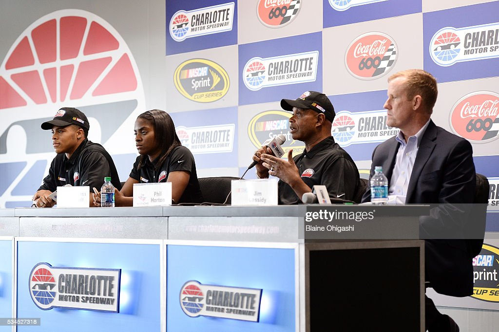 From left, NASCAR Drive for Diversity Pit Crew National Combinee participants Joshua Tate and Brehanna Daniels, Rev Racing Director of Athletic Performance Phil Horton, and NASCAR Senior Vice President of Racing Operations Jim Cassidy speak to the media during practice for the NASCAR Sprint Cup Series Coca-Cola 600 at Charlotte Motor Speedway on May 27, 2016 in Charlotte, North Carolina.