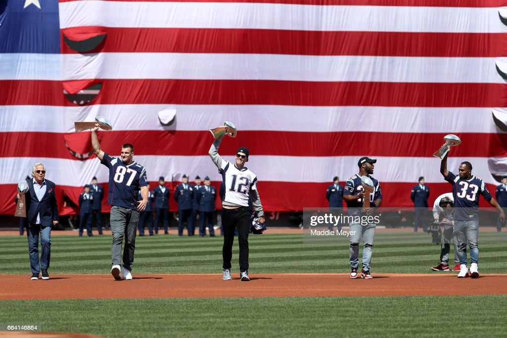 From left, New England Patriots owner Robert Kraft, Rob Gronkowski #87, Tom Brady #12, James White #28 and Dion Lewis #33 walk onto the field carrying Vince Lombardi trophies before the opening day game between the Boston Red Sox and the Pittsburgh Pirates at Fenway Park on April 3, 2017 in Boston, Massachusetts.