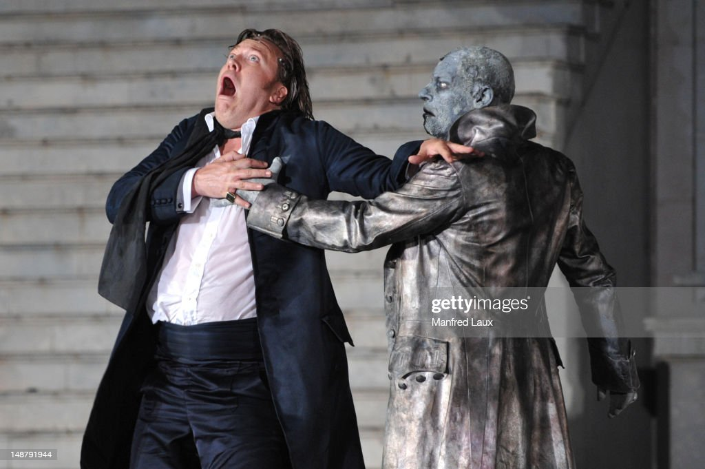 From left Nicholas Ofczarek and Ben Becker is seen during the photo rehearsal of 'Jedermann' on the Domplatz ahead of Salzburg Festival 2012 on July...