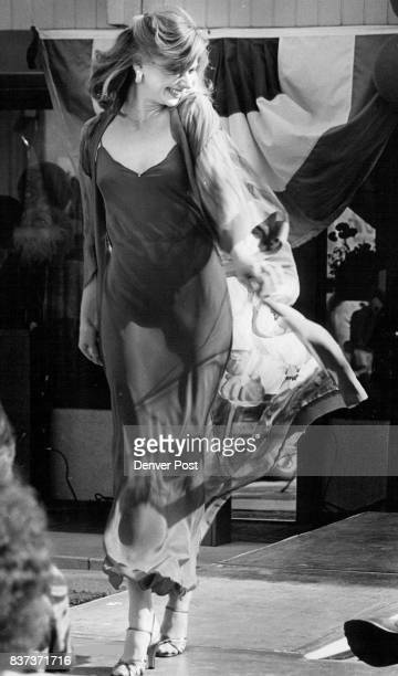 From left Ora Feder's red silk crepe gown with a hand painted chiffon robe show's briefest lingerie was an ivory satin teddy with camisole topped by...