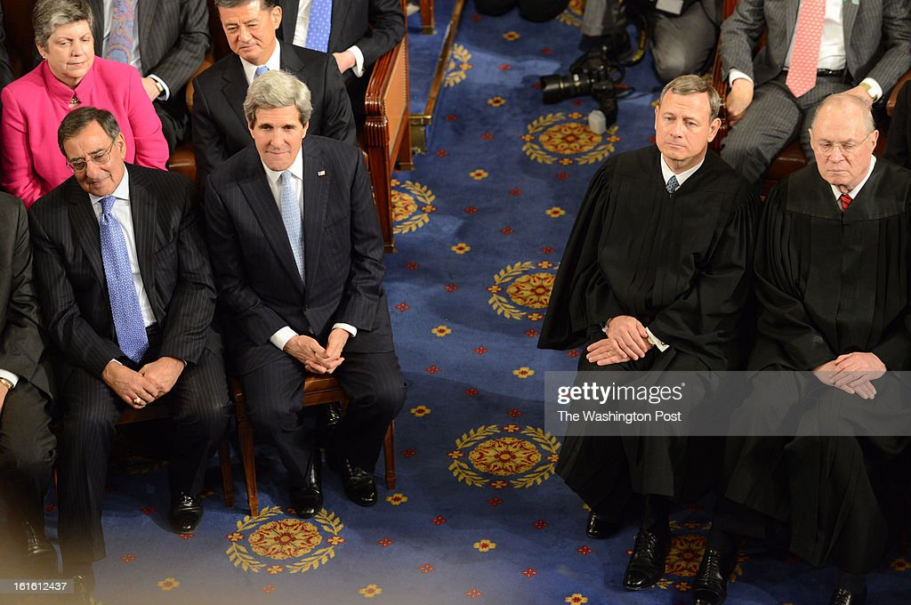 From left outgoing Secretary of Defense Leon Panetta Secretary of State John Kerry Supreme Court Chief Justice John Roberts and supreme Court Justice...