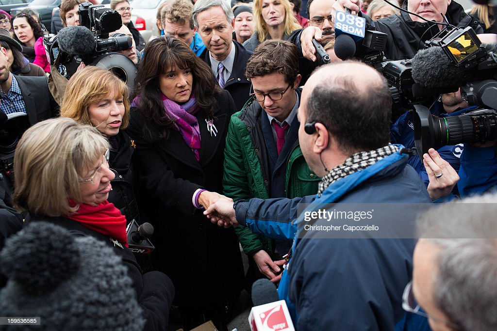 From left, Pam Simon who worked for Gabrielle Gifford, Lori Haas, who's daughter was shot and injured in the Virginia Tech shootings, Roxanna Green, and Anthony Mercurio, from SumOfUs, address the Danbury, Conn., Walmart Manager John Ruggieri outside the Danbury Walmart January 15, 2013 in Danbury, Connecticut. Gun control advocates along with parents of victims and gun violence survivors joined together to urge Walmart, the nation's largest gun retailer to stop the sale of assault weapons and munitions in their stores nationwide.