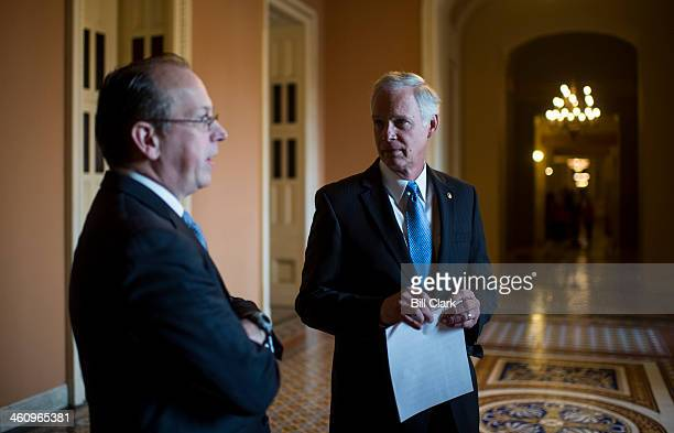 From left Paul Clement former United States Solicitor General and Sen Ron Johnson RWisc talk in the hallway before the start of their news conference...