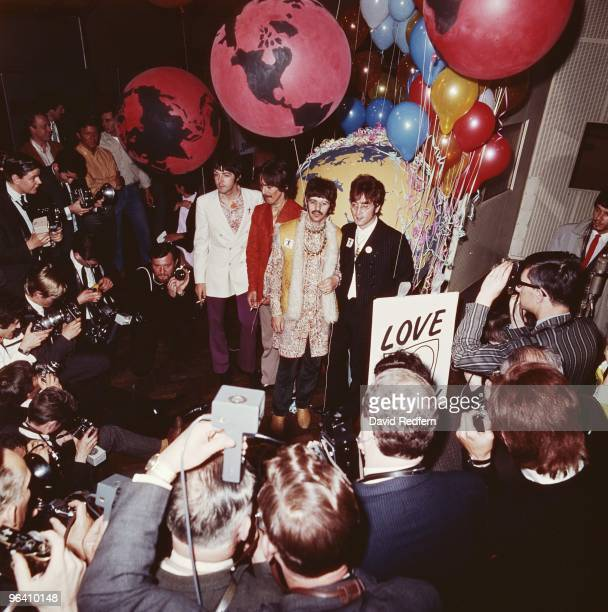 Paul McCartney George Harrison Ringo Starr and John Lennon of The Beatles pose in front of the press for a group shot at Abbey Road Studios in London...