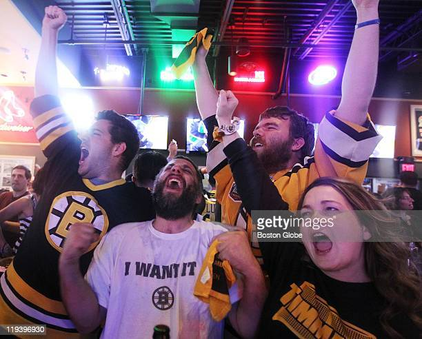 From left Paul Rogers Bob Kennedy Jeff Fox and Sherie Schuettner celebrate Wednesday at Buffalo Wild Wings in Saugus Mass after the Boston Bruins...