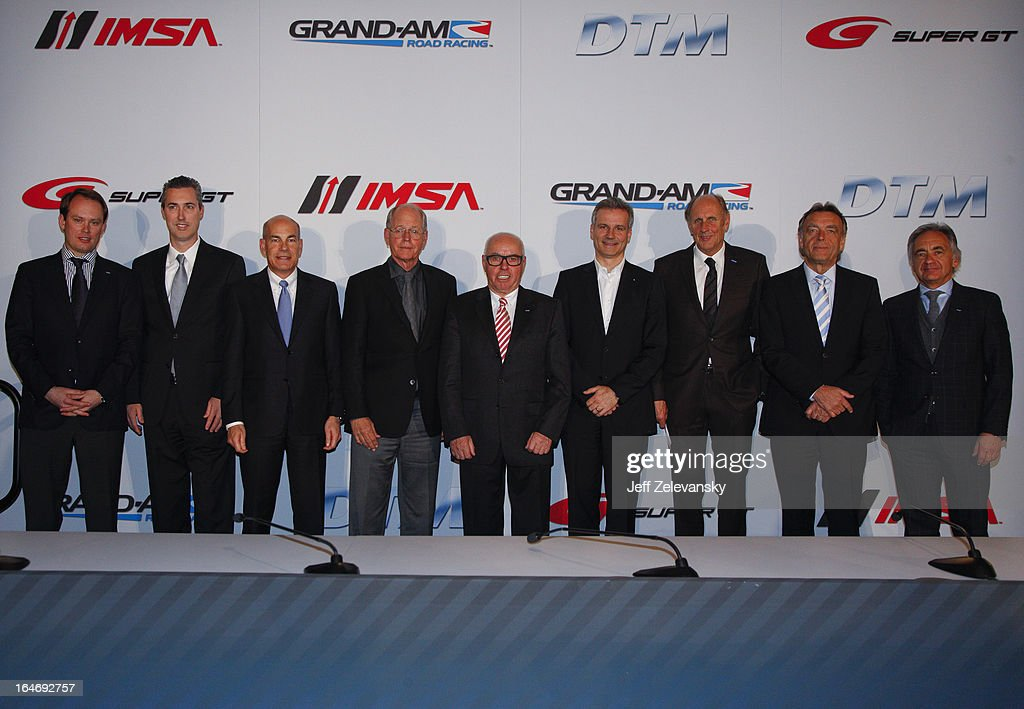 From left, Phillipp Berkessy, ITR Marketing Director, Ed Bennett, President and C.E.O. GRAND-AM Road Racing, Scott Atherton, President and C.E.O. American Le Mans Series presented by Tequila Patron, Jim France, Executive Vice President/Secretary, NASCAR, Hans Werner Aufrecht, ITR Board Member, Jens Marquardt, Director, BMW Motorsport, Hans-Joachim Stuck, President, DMSB and Wolfgang Schattling, Director Motorsport Communications, Mercedes-Benz and Juergen Pippig, Executive Board Member, DTM ITR GmbH pose for a photograph at a news conference to announce the GRAND AM IMSA DTM technical license cooperation agreement at the Intercontinental Hotel on March 26, 2013 in New York City.