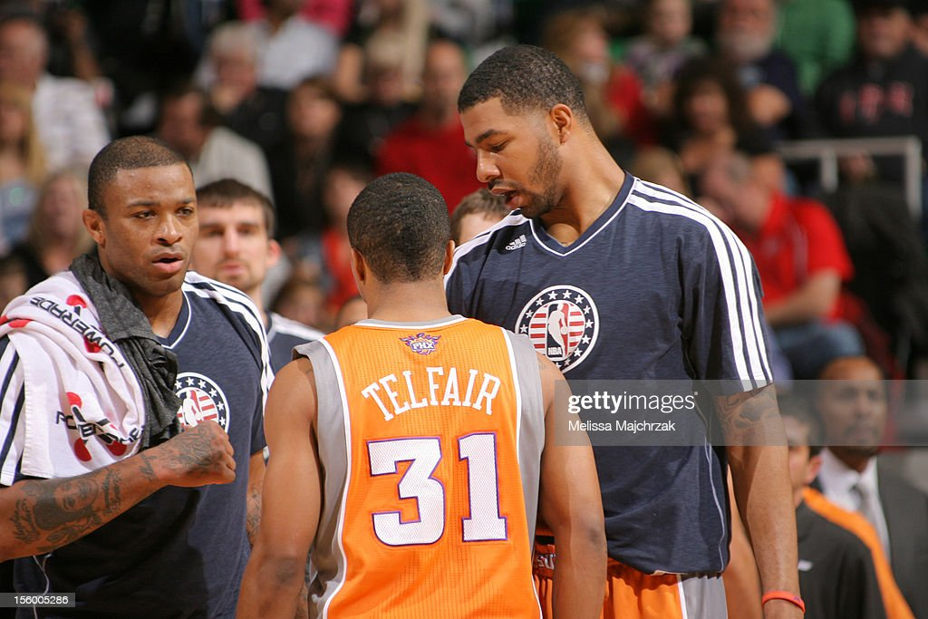 P.J. Tucker #17, Sebastian Telfair #31, and Markieff Morris #11 of the Phoenix Suns on the sideline during their Utah Jazz matchup at Energy Solutions Arena on November 10, 2012 in Salt Lake City, Utah.