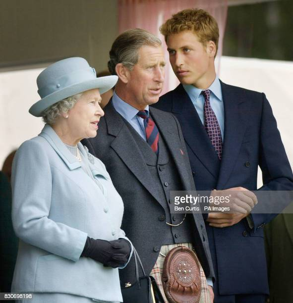 From left Queen Elizabeth II The Prince of Wales and Prince William stand in the pavillion at the Braemar Games in Royal Deeside Scotland