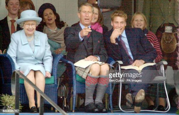 From left Queen Elizabeth II The Prince of Wales and Prince William watch the sack race at the Braemar Games in Royal Deeside Scotland The Braemar...