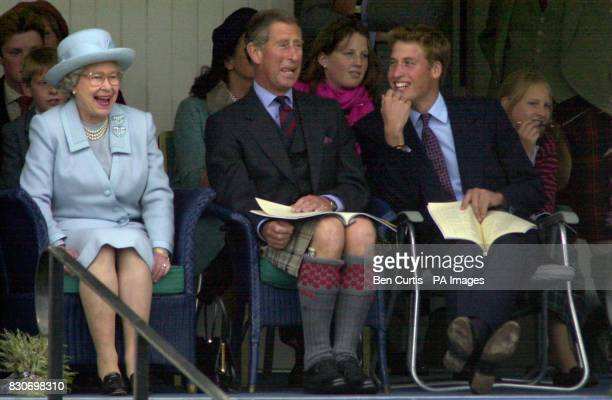 From left Queen Elizabeth II The Prince of Wales and Prince William watch the sack race at the Braemar Games in Royal Deeside Scotland