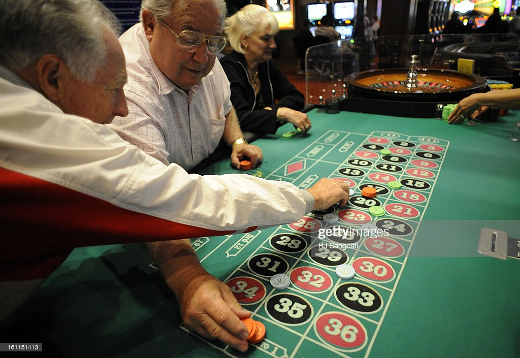ROULETTE17  From Left, Ray Hein, Of Westminster, John Bradley, Of Denver,  And Cindy Rpzmarich, Of Aurora, Place Their Chip On The Table At The Gilpin  Casino ...