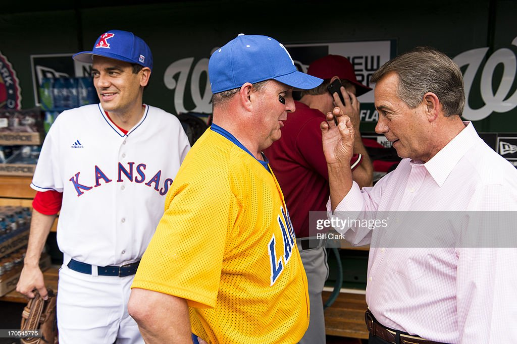 From left, Rep. Kevin Yoder, R-Kan., looks on as Rep. Jeff Duncan, R-Fla., gets a pep talk from Speaker of the House John Boehner, R-Ohio, in the Republicans' dugout before the 52nd annual Congressional Baseball Game at national Stadium in Washington on Thursday, June 13, 2013.
