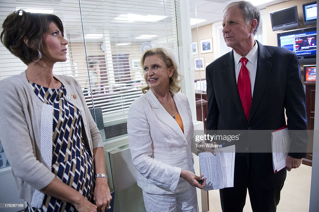 From left, Rep. Kristi Noem, R-S.D., Carolyn Maloney, D-N.Y., and Ted Poe, R-Texas, prepare for a news conference in the Capitol on legislation to reduce human trafficking by targeting those who purchase sexual acts.